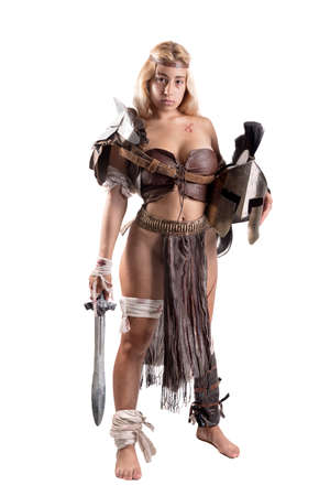 Ancient woman warrior or Gladiator posing with sword and shield, isolated in white Zdjęcie Seryjne