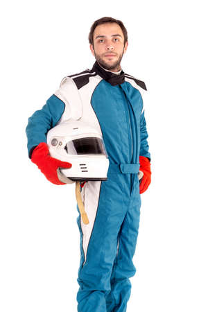 Racing driver posing with helmet isolated in white