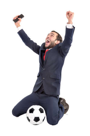 Businessman with soccer ball celebrating isolated in white