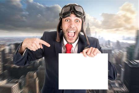 Businessman with pilot goggles and white board i Zdjęcie Seryjne