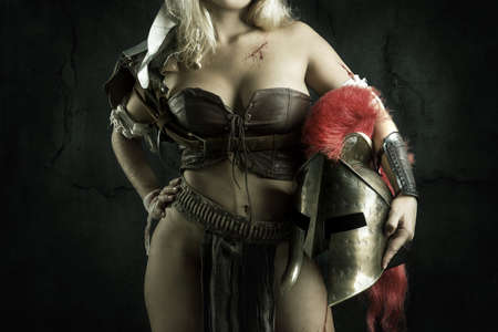 Ancient woman warrior or Gladiator body part, against a dark background Zdjęcie Seryjne