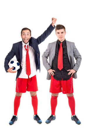 Businessmen with soccer ball posing isolated in white