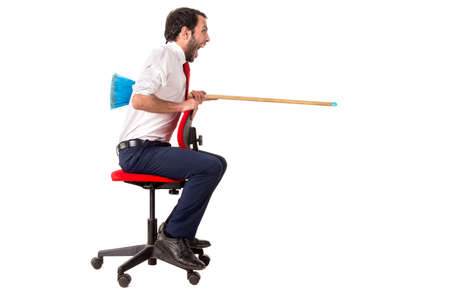 worker in a chair jousting with a broom, isolated in white Zdjęcie Seryjne