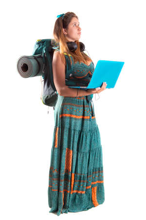 Happy hiker girl with backpack and computer, isolated in white, trekking and travel lifestyle concept Zdjęcie Seryjne