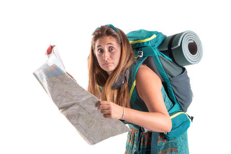 Confused hiker girl with backpack and map, isolated in white, trekking and travel lifestyle concept Zdjęcie Seryjne