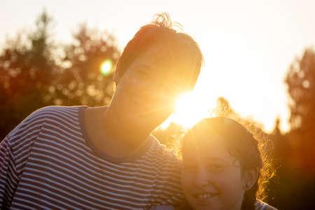Kid's couple posing outdoors at sunset Zdjęcie Seryjne