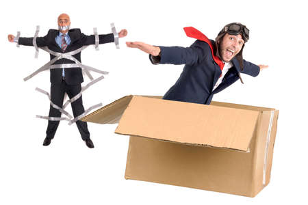 Businessman escaping,  flying a carboard box isolated in white
