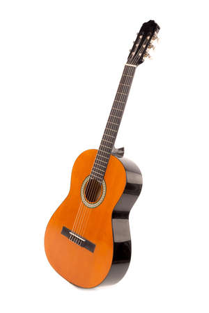 Acoustic guitar isolated in a white background