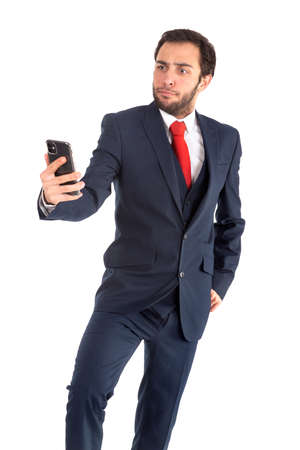 Businessman or stock broker looking at mobile phone