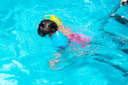 toddler alone diving in the swimming pool