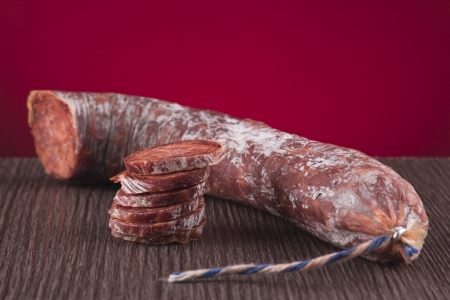 Chorizo iberico in a table on a red background photo