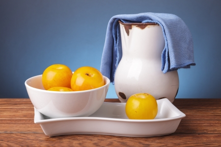 Still life with fresh fruits in white containers photo