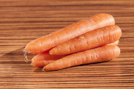 set of carrots on a wooden countertop