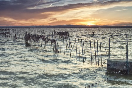 Sunset on the Albufera Nature Park, Valencia, Spain, with fishing nets