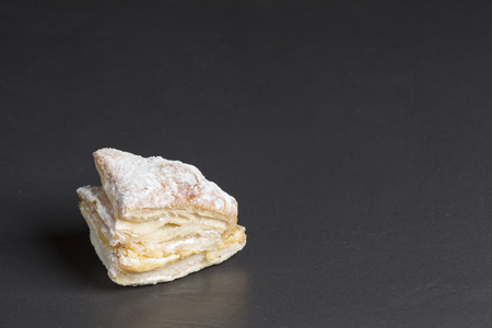 Puff pastry cake with cream and powdered sugar Stock Photo