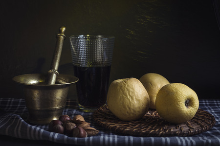 Still life with apples, wine and nuts Stock Photo