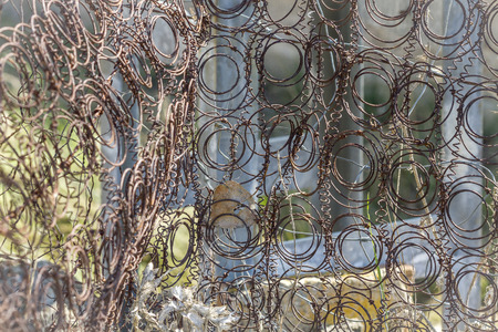 bare wire: rusty mattress springs and abandoned outdoors