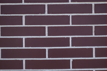 brick wall of different colors with geometric shapes photo