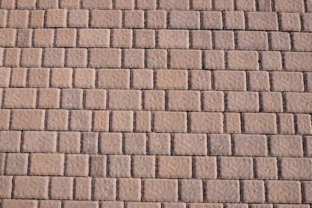 sidewalk tile regular colors and geometric shapes photo