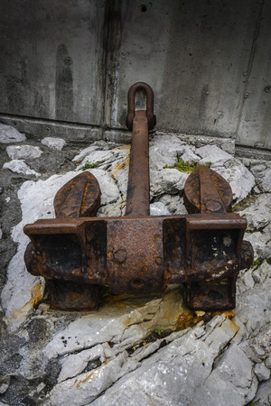 an anchor of an old rusty and secluded ship in a port