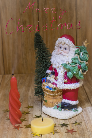 customs and celebrations: Santa Claus with candle and Christmas tree