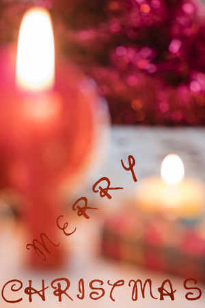 customs and celebrations: ornaments with a candle and Christmas gifts Stock Photo