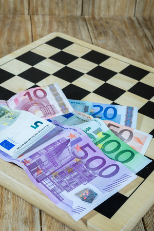 power of money: a chessboard, figures and money in the game of economics and power