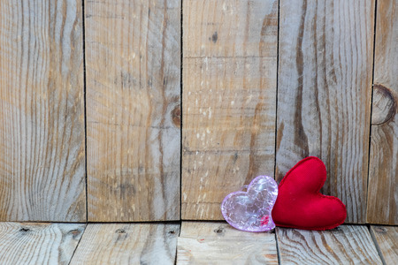 wish desire: two red hearts on a wooden background for Valentines Day