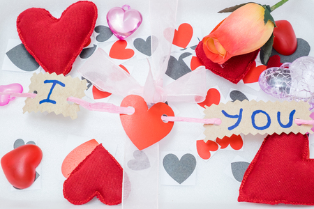 romantic flowers: many hearts of different colors and shapes and a pink ribbon on a white background Stock Photo