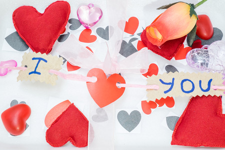 i hope: many hearts of different colors and shapes and a pink ribbon on a white background Stock Photo