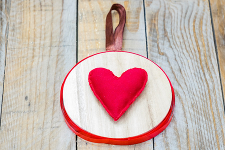 i hope: wood pendant with a red heart in the center