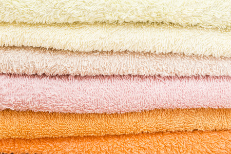 laundered: freshly laundered bath towels stacked and folded in different colors Stock Photo