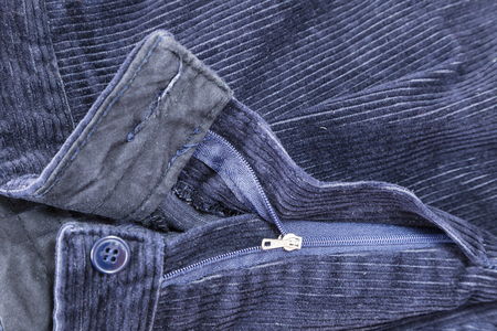 corduroy: fashion clothing, zipper and button blue corduroy trousers used Stock Photo