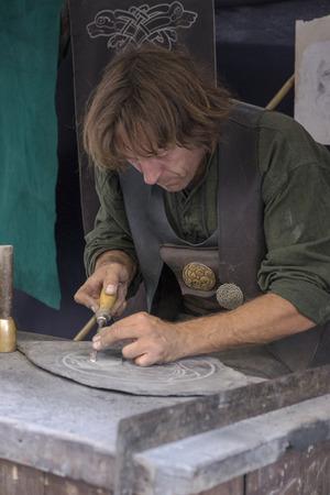 stonemason: Avila, Spain - September 03, 2016 exhibition of stonemason in a medieval market