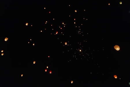 Sky lanterns flying above the beautiful city of Avila Stock Photo