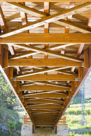View of the nerves of the lower structure of a wooden bridge of a city Stock Photo