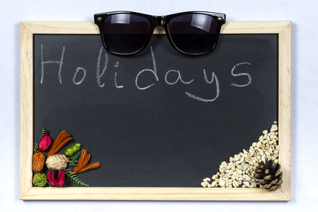 Space chalkboard background texture with wooden frame with the word Holidays. blackboard space for wallpaper. Landscape mounting style horizontal.