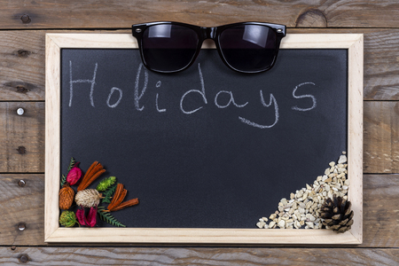 mounting: Space chalkboard background texture with wooden frame with the word Holidays. blackboard space for wallpaper. Landscape mounting style horizontal.