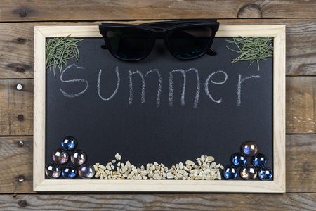 formula one: Space chalkboard background texture with wooden frame with the word Summer. blackboard space for wallpaper. Landscape mounting style horizontal. Stock Photo