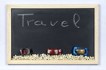 mounting: Space chalkboard background texture with wooden frame with the word Travel. blackboard space for wallpaper. Landscape mounting style horizontal. Stock Photo