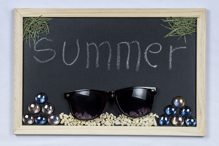 mounting: Space chalkboard background texture with wooden frame with the word Summer. blackboard space for wallpaper. Landscape mounting style horizontal. Stock Photo
