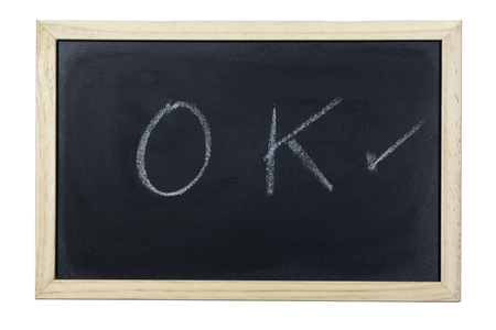 Space chalkboard background texture with wooden frame with the word OK. blackboard space for wallpaper. Landscape mounting style horizontal. Stock Photo