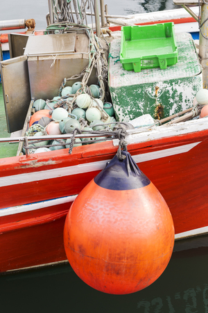 details of a fishing boat moored in a small harbor