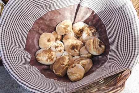 wicker basket full of fresh breads in a market Stock Photo