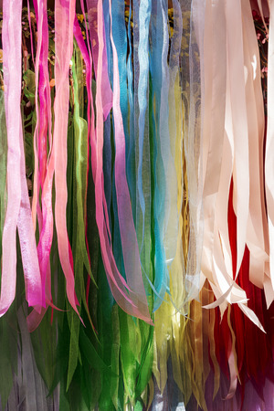 background of strips of silk fabric of various colors