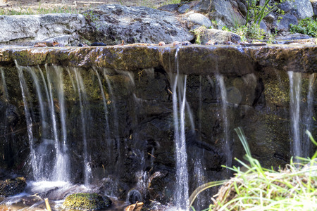 small waterfall of a stream of clear waters Stock Photo