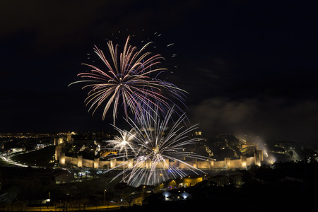 night views of fireworks in the city of Avila in Spain, medieval walled city perfectly preserved