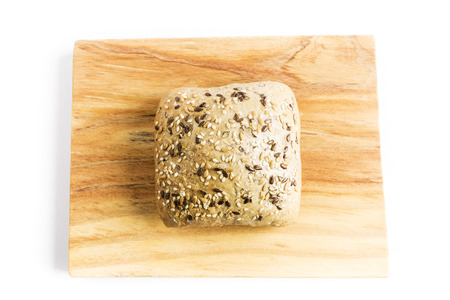 Bread with flax seeds, oats and sesame on a wooden board