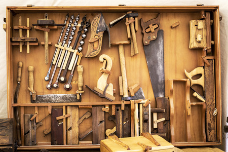 old carpenter's manual tools in an old carpentry shop Stockfoto