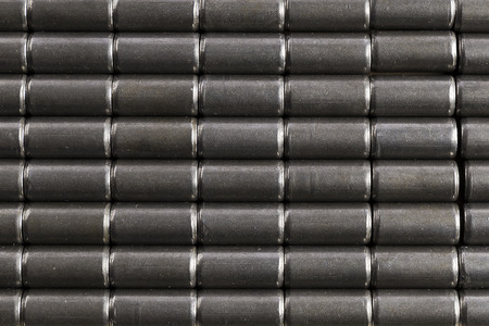Gray background of small iron cylindrical pieces to use in advertising as a background Stock Photo